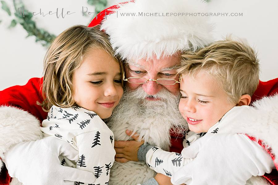 boys snuggling Santa