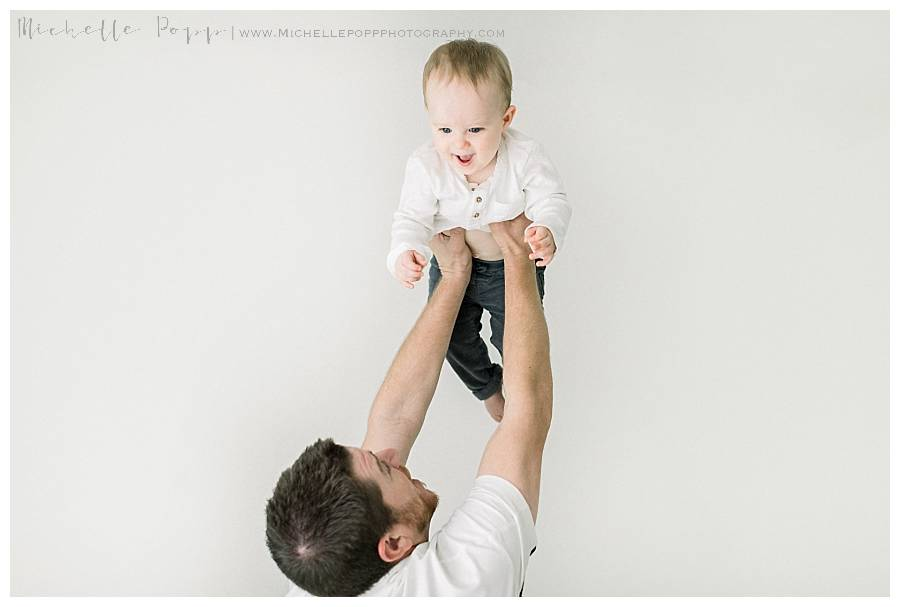 dad lifting son into air