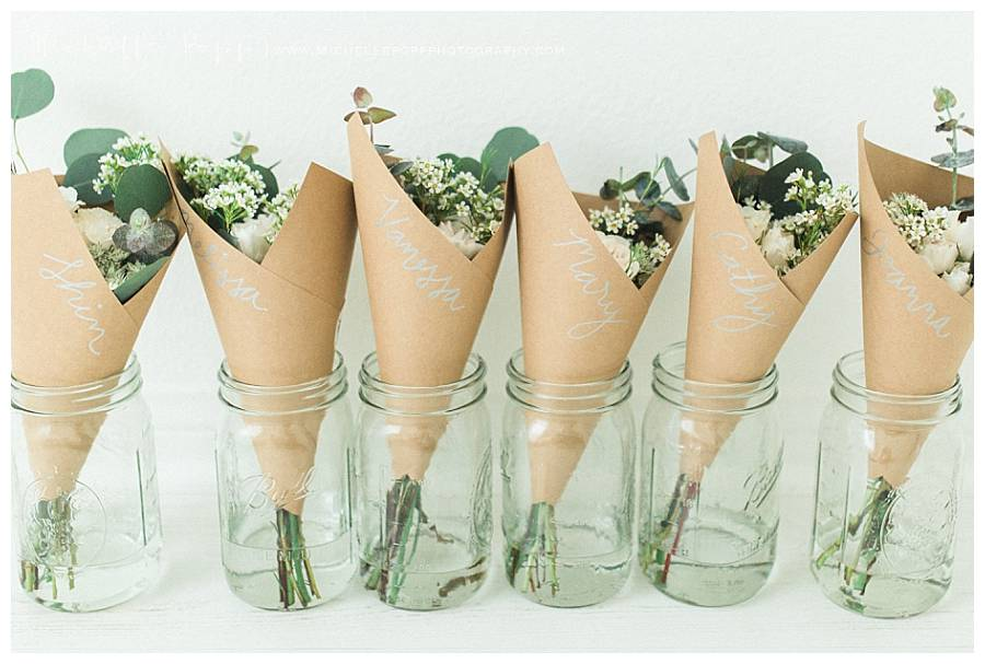 flowers wrapped in brown paper in vases