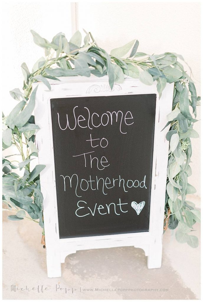 welcome sign for motherhood event